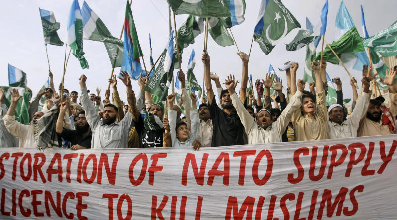 Supporters of Pakistani religious party Jamaat-e-Islami chant slogans during a rally condemning the movement of NATO supplies to Afghanistan through Pakistan, in Karachi, Pakistan, Sunday, July 15, 2012. (AP Photo/Fareed Khan)