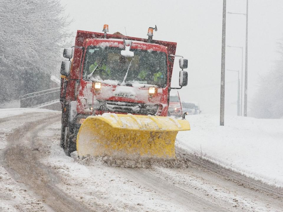 <p>A snow plough and grit spreader works to clear the roads in Barnsley, South Yorkshire. Yellow weather warnings have been issued</p> (Jamie Lorriman)