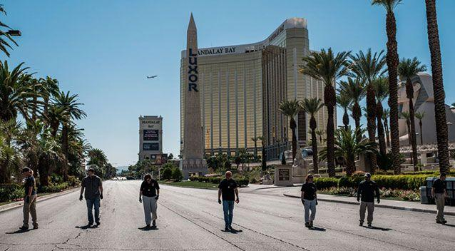 Members of the FBI sweep a stretch of South Las Vegas Boulevard, which is still closed to the public. Source: Nick Otto via ZUMA Wire via Yahoo US