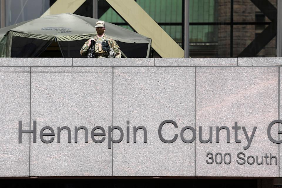 A National Guard soldier is seen outside the Hennepin County Government Center as jury selection continues in the trial of former police Derek Chauvin, who is facing murder charges in the death of George Floyd, in Minneapolis, Minnesota, March 22, 2021. REUTERS/Nicholas Pfosi
