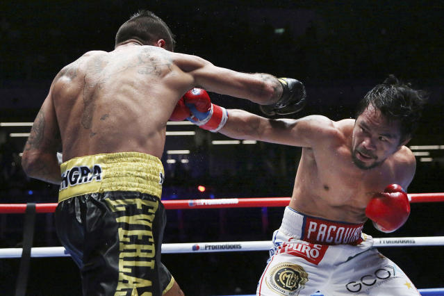 Manny Pacquiao of the Philippines, right, fights Lucas Matthysse of Argentina during their WBA World welterweight title bout in Kuala Lumpur, Malaysia, Sunday, July 15, 2018. Pacquiao won the WBA welterweight world title after a technical knockout in the 7th round. (AP Photo/Yam G-Jun)