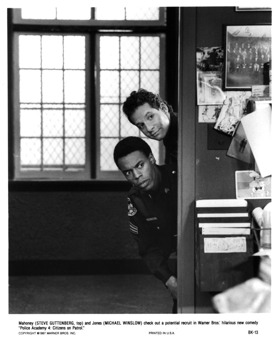 Actors Steve Guttenberg and Michael Winslow in 'Police Academy 4: Citizens on Patrol,' 1987. (Photo: Michael Ochs Archives/Getty Images)