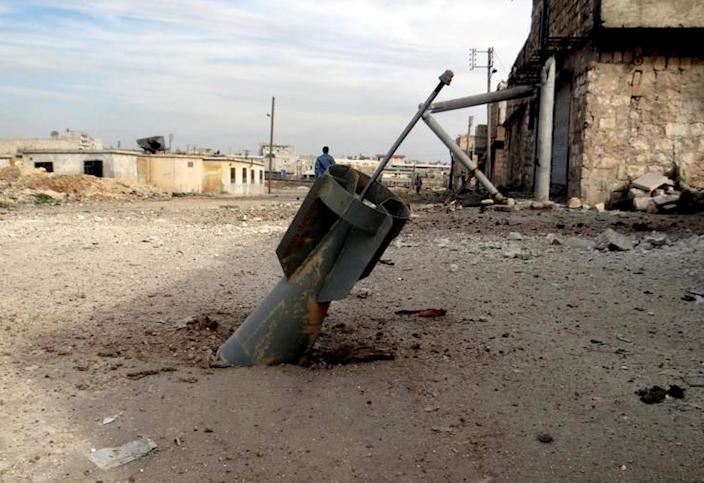 This citizen journalism image provided by Aleppo Media Center AMC which has been authenticated based on its contents and other AP reporting, shows an unexploded rocket from a Syrian warplane, in the neighborhood of Karam Alqasir, near Aleppo International Airport, in Aleppo, Syria, Thursday, Feb. 21, 2013. A car bomb near the Damascus headquarters of Syria's ruling party killed scores on Thursday, while a government airstrike on a rebel field hospital in southern Daraa left several dead, opposition activists and state media reported. (AP Photo/Aleppo Media Center AMC)