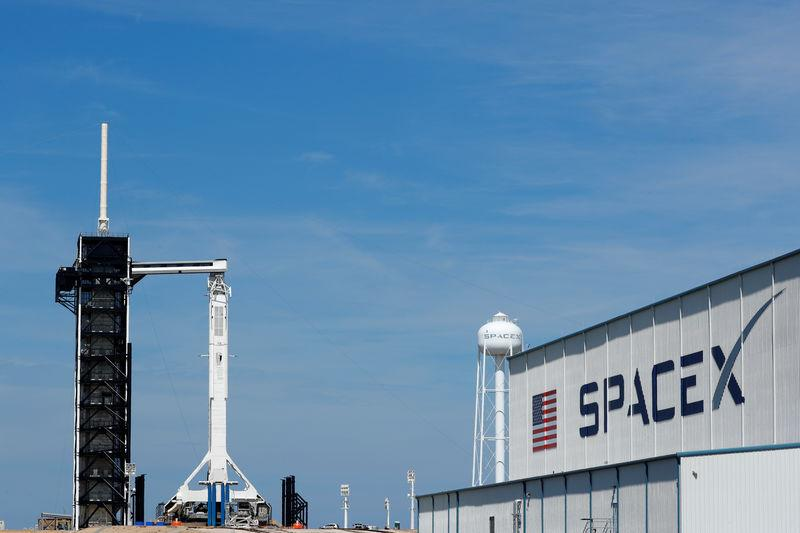 A SpaceX Falcon 9 carrying the Crew Dragon spacecraft sits on launch pad 39A prior to the uncrewed test flight to the International Space Station from the Kennedy Space Center in Cape Canaveral