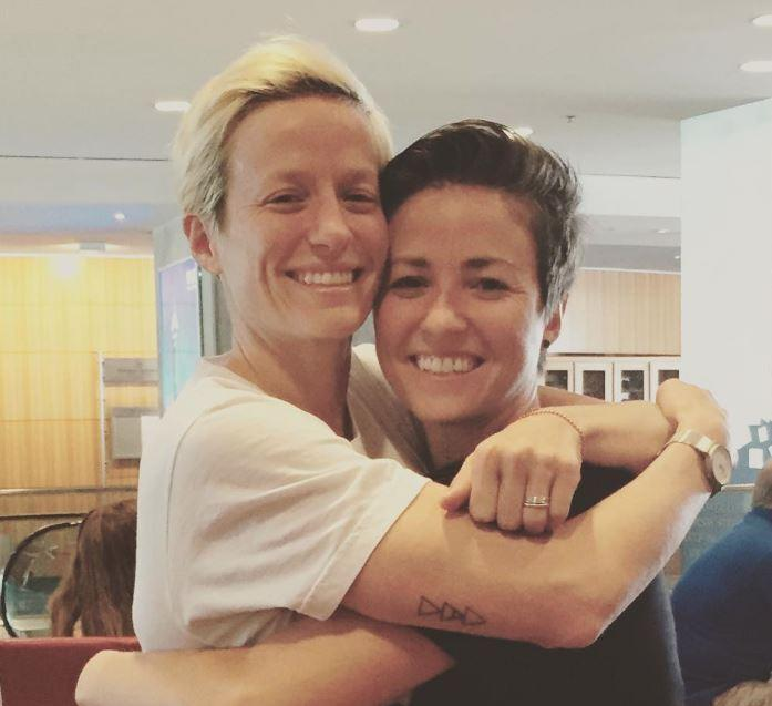 Megan and Rachael Rapinoe hugging each other