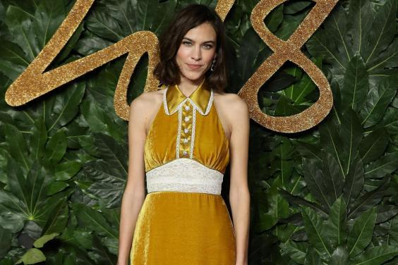 One bidder will get a bespoke dress designed and worn by Alexa Chung (AFP/Getty)
