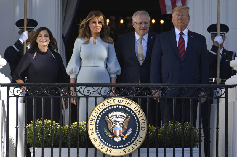 President Donald Trump, right, and first lady Melania Trump, second from left, pose for a photo with Australian Prime Minister Scott Morrison, second from right, and his wife Jenny Morrison, left, during a state arrival ceremony on the South Lawn of the White House in Washington, Friday, Sept. 20, 2019. (AP Photo/Susan Walsh)
