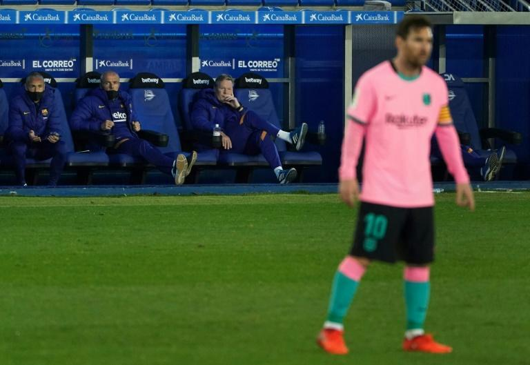 Koeman (seated, right) denies Messi is difficult to manage