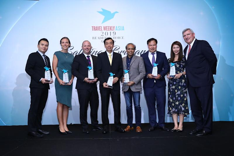 Winners of the Airline category awards pose alongside Robert Sullivan (first from right), president of Northstar Travel Group. (PHOTO: Travel Weekly Asia)