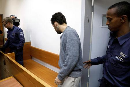 An U.S.-Israeli teen who was arrested in Israel arrives before the start of a remand hearing at Magistrate's Court in Rishon Lezion