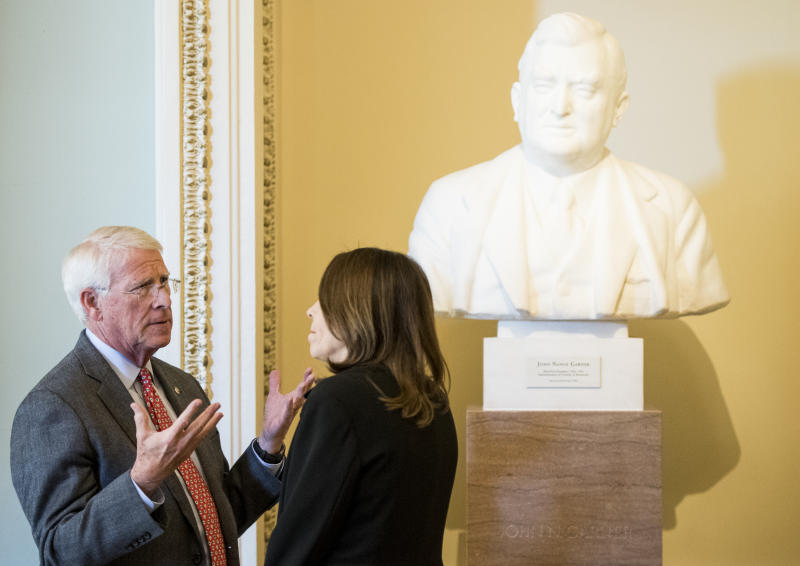 UNITED STATES - DECEMBER 3: Sen. Roger Wicker, R-Miss., and Sen. Maria Cantwell, D-Wash., talk in the Ohio Clock Corridor in the Capitol on Tuesday, Dec. 3, 2019. (Photo By Bill Clark/CQ-Roll Call, Inc via Getty Images)