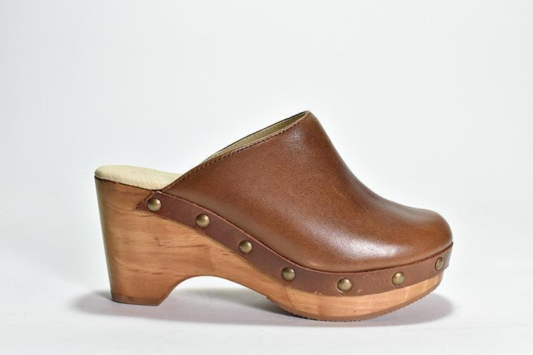 "<h2>Cordani Zorba Clogs<br></h2><br>A clog to know? The Zorba: a classic, Italian-made style from Boston-based comfort footwear brand Cordani. This slip-on shoe features chic a rubber-coated wooden base, polished suede upper, and our favorite detail — a subtle nailhead trim. The Zorba is one of the brand's most-requested styles, but we're also seriously eyeing the <a href=""https://www.cordani.com/products/zandie"" rel=""nofollow noopener"" target=""_blank"" data-ylk=""slk:Zandie"" class=""link rapid-noclick-resp"">Zandie</a>, the brand's ankle-height boot style.<br><br><strong>Cordani</strong> Zorba Clog, $, available at <a href=""https://go.skimresources.com/?id=30283X879131&url=https%3A%2F%2Fwww.cordani.com%2Fcollections%2Fclogs%2Fproducts%2Fcopy-of-zorba"" rel=""nofollow noopener"" target=""_blank"" data-ylk=""slk:Cordani"" class=""link rapid-noclick-resp"">Cordani</a>"