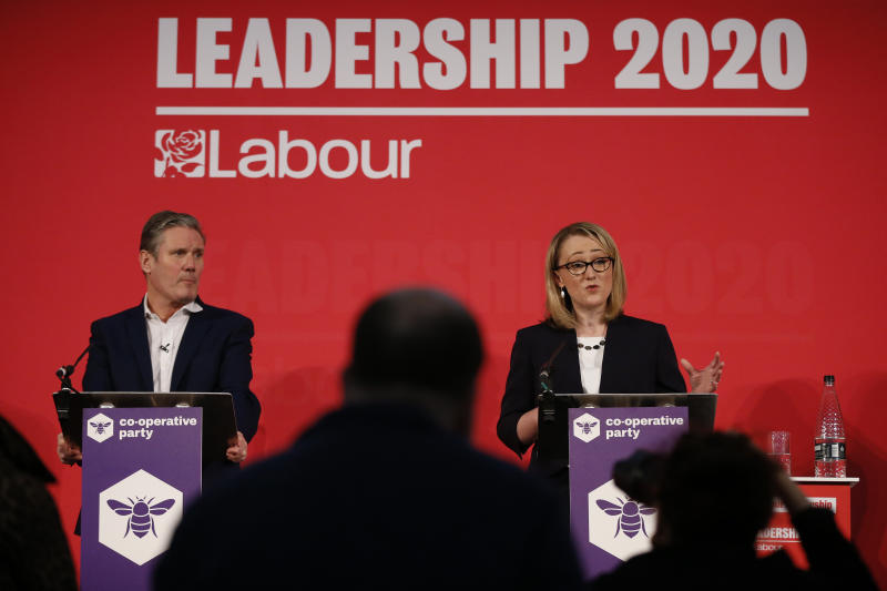LONDON, ENGLAND - FEBRUARY 16: Sir Keir Starmer listens to Rebecca Long-Bailey speaking at a hustings event for Labour Leader and Deputy Leader, hosted by the Co-operative Party, at the Business Design Centre on February 16, 2020 in London, England. Sir Keir Starmer, Rebecca Long-Bailey and Lisa Nandy are vying to replace Labour leader Jeremy Corbyn, who offered to step down following his party's loss in the December 2019 general election. (Photo by Hollie Adams/Getty Images)