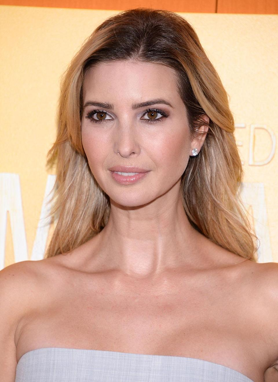 <p>Soft browns and pink shadows help to show off Ivanka's bare shoulders and off-the-face hair. (Photo: AP Images) </p>