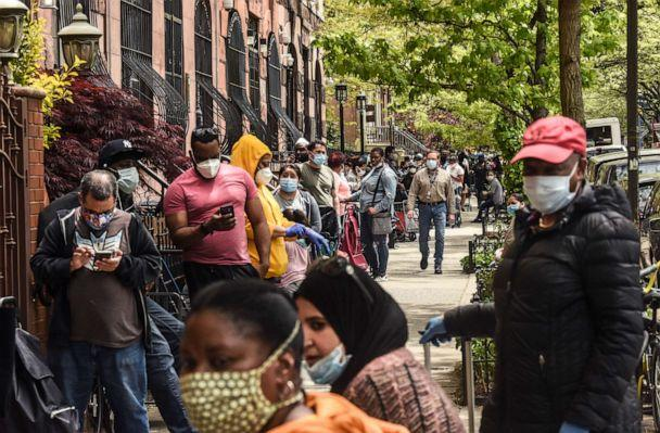 PHOTO: People wait on a long line to receive a food bank donation at the Barclays Center, May 15, 2020, in the Brooklyn borough in New York City. (Stephanie Keith/Getty Images)