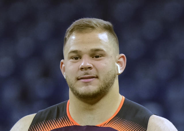 FILE - Ijn this Feb. 28, 2019, file photo, NC State offensive lineman Garrett Bradbury participates in a drill during the NFL football scouting combine in Indianapolis. Bradbury is a possible pick in the 2019 NFL Draft. (AP Photo/AJ Mast, File)