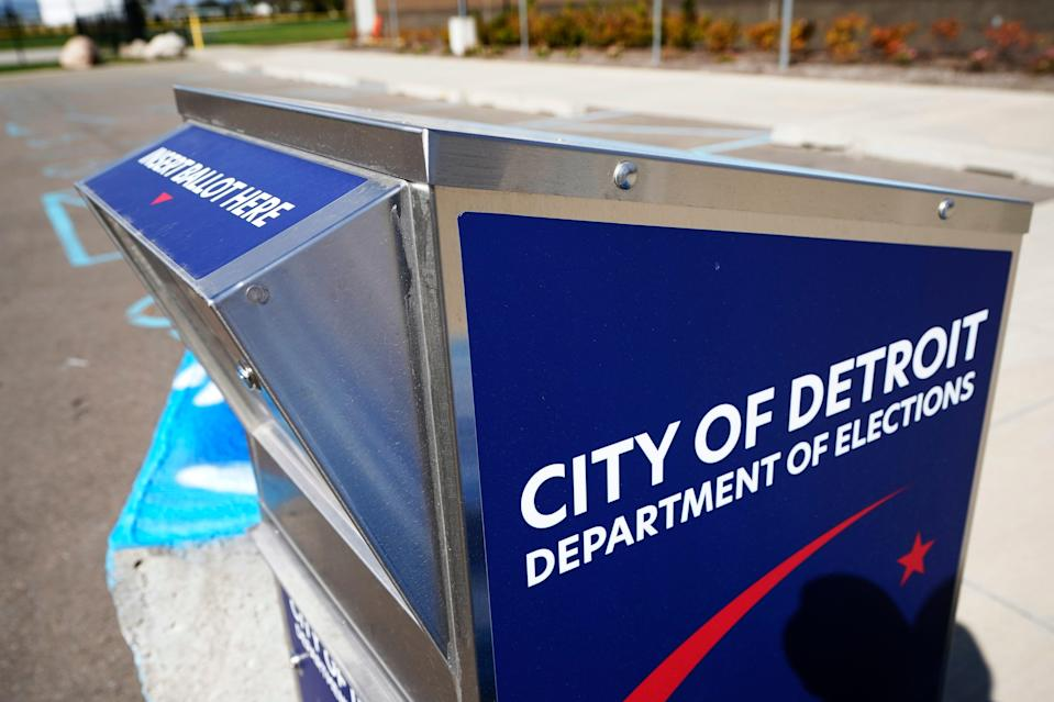 A ballot drop box is shown where voters can drop off absentee ballots instead of using the mail in, Friday, Oct. 16, 2020, in Detroit. (AP Photo/Carlos Osorio) ORG XMIT: otkco103