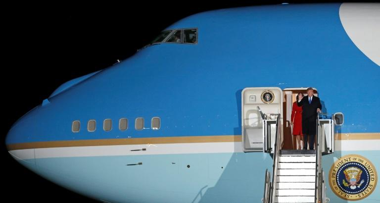 US President Donald Trump and First Lady Melania Trump (L) prepare to disembark from Air Force One after landing at Stansted Airport, northeast of London ahead of the upcoming NATO summit