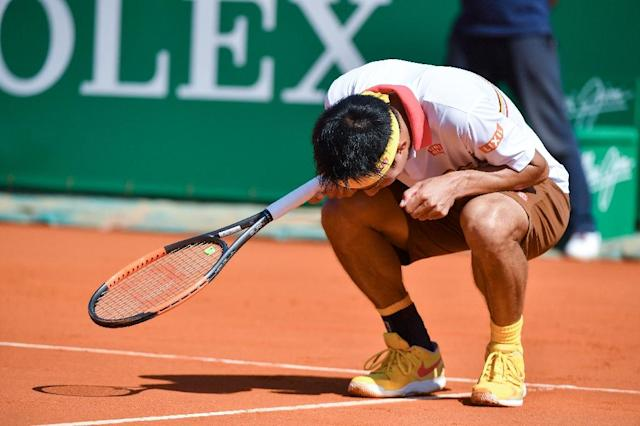 Nishikori started well, but threw away an early break and never recovered as Nadal went from strength to strength (AFP Photo/Yann COATSALIOU)