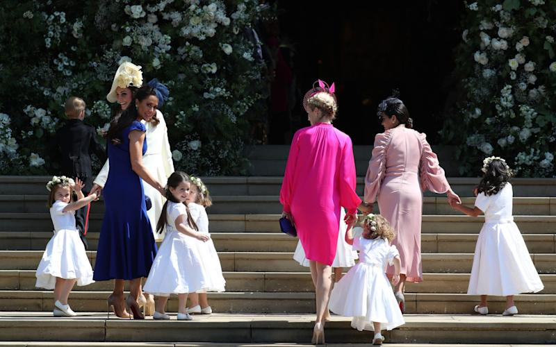 The Duchess of Cambridge took charge, leading the children into the chapel - PA