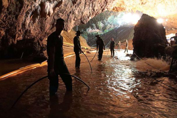 PHOTO: Thai Navy soldiers in the flooded Tham Luang cave during rescue operations for the 12 boys and their football team coach trapped in the cave at Khun Nam Nang Non Forest Park in the Mae Sai district of Chiang Rai province. (Royal Thai Navy/AFP/Getty Images)