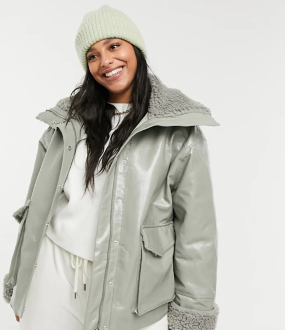 ASOS DESIGN Curve Leather-Look Jacket With Shearling Lining in Sage (Photo via ASOS)
