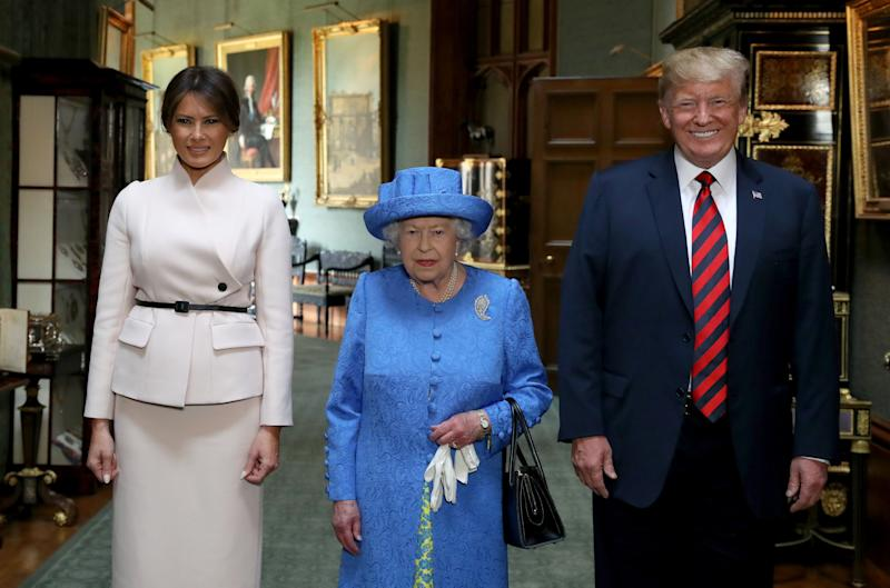 "Britain's Queen Elizabeth II (C) stands with US President Donald Trump (R) and US First Lady Melania Trump (L) in the Grand Corridor at Windsor Castle in Windsor, west of London, on July 13, 2018 during an engagement on the second day of Trump's UK visit. - US President Donald Trump launched an extraordinary attack on Prime Minister Theresa May's Brexit strategy, plunging the transatlantic ""special relationship"" to a new low as they prepared to meet Friday on the second day of his tumultuous trip to Britain. (Photo by Steve Parsons / POOL / AFP) (Photo by STEVE PARSONS/POOL/AFP via Getty Images)"