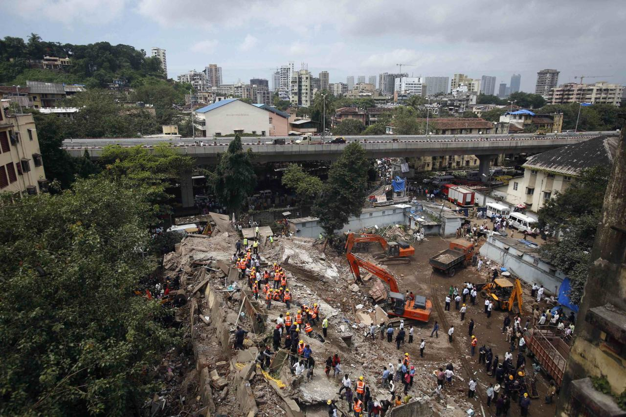 Rescue crews search for survivors at the site of a collapsed residential building in Mumbai September 27, 2013. The five-storey apartment block collapsed on Friday in the Indian financial centre of Mumbai, killing one person with dozens feared trapped in the latest accident to underscore shoddy building standards in Asia's third-largest economy. REUTERS/Danish Siddiqui (INDIA - Tags: DISASTER TPX IMAGES OF THE DAY)