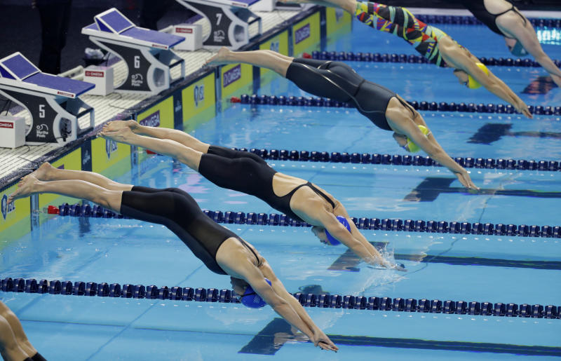 Competitors start the women's 200-meter freestyle during an International Swimming League event Friday, Dec. 20, 2019, in Las Vegas. (AP Photo/John Locher)