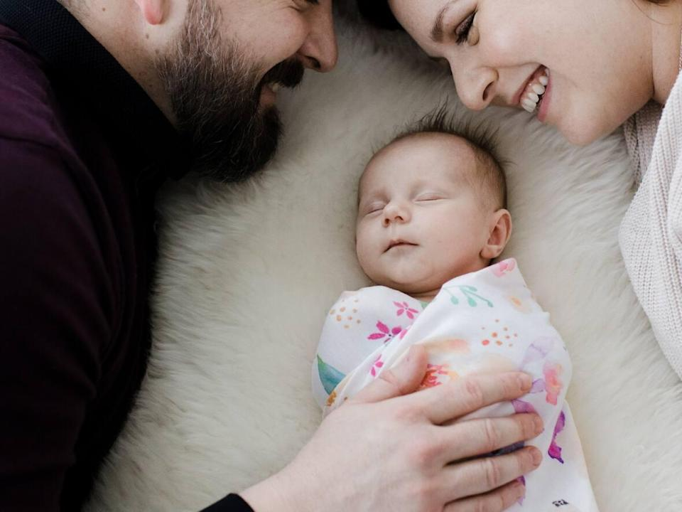 Graham Dickson and Laura Weins are shown with their daughter, Helen.  (Submitted by Chelsea Klette - image credit)