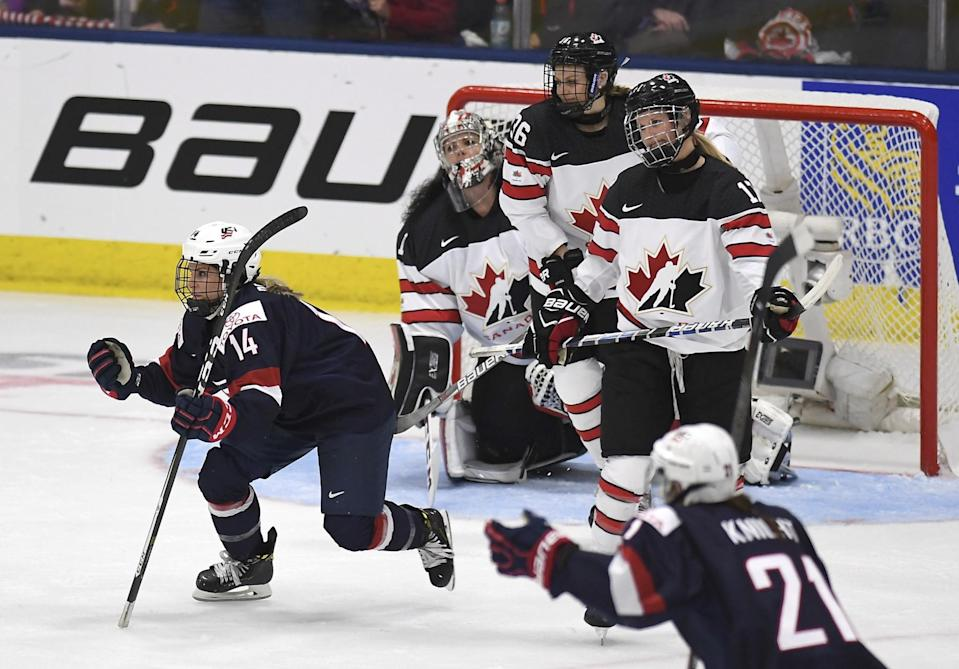 United State's Brianna Decker (14)celebrates her goal during the second period of a IIHF Women's World Championship hockey tournament game against Canada, Friday, March 31, 2017, in Plymouth, Mich. In the background right is Canada forward Blayre Turnbull. (Jason Kryk/The Canadian Press via AP)