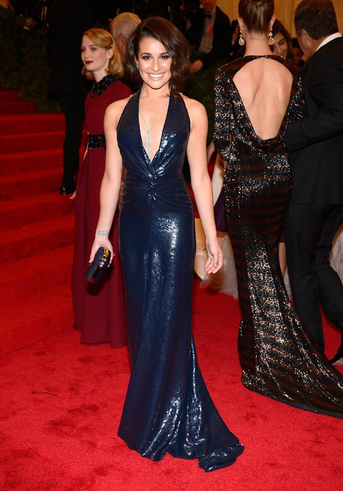 Lea Michele wore a low-cut, sparkly navy Diane von Furstenberg dress with matching clutch, Christian Louboutin shoes, and Lorraine Schwartz jewels to the 2012 Met Ball held at the Metropolitan Museum of Art on May 7, 2012 in New York City.<em></em>