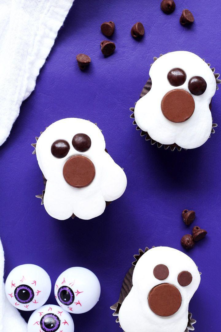 """<p>Prepare these candy-topped confections using any cupcake recipe you'd like. Whether you choose chocolate, vanilla, or something different, any flavor would be delicious. </p><p><strong>Get the recipe at <a href=""""https://thebearfootbaker.com/2016/09/ghost-cupcakes/"""" rel=""""nofollow noopener"""" target=""""_blank"""" data-ylk=""""slk:The Bearfoot Baker"""" class=""""link rapid-noclick-resp"""">The Bearfoot Baker</a>.</strong><br></p><p><strong><a class=""""link rapid-noclick-resp"""" href=""""https://go.redirectingat.com?id=74968X1596630&url=https%3A%2F%2Fwww.walmart.com%2Fip%2FWilton-No-1A-Round-Decorating-Tip%2F49252781&sref=https%3A%2F%2Fwww.countryliving.com%2Ffood-drinks%2Fg1366%2Fhalloween-cupcake-ideas%2F"""" rel=""""nofollow noopener"""" target=""""_blank"""" data-ylk=""""slk:SHOP DECORATING TIPS"""">SHOP DECORATING TIPS</a><br></strong></p>"""