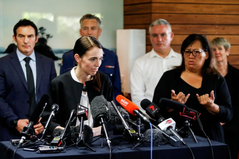 New Zealand's Prime Minister Jacinda Ardern reacts while addressing the media in the aftermath of the eruption of White Island volcano, at Whakatane