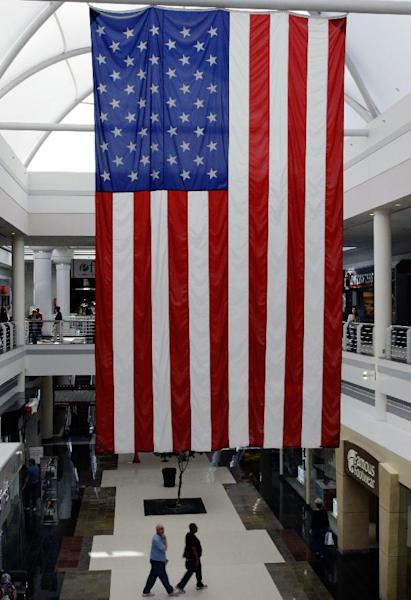 In this Friday, Oct. 26, 2012, photo, people shop at a mall in Cheektowaga, N.Y. Americans spent briskly in October before Superstorm Sandy hit the Northeast, but the question is whether they're still willing to get an iPhone for Christmas if they plunked down hundreds on a generator for Sandy. The storm, which hit at the East Coast at the tail-end of October, did not appear to negatively impact sales during the month.(AP Photo/David Duprey)