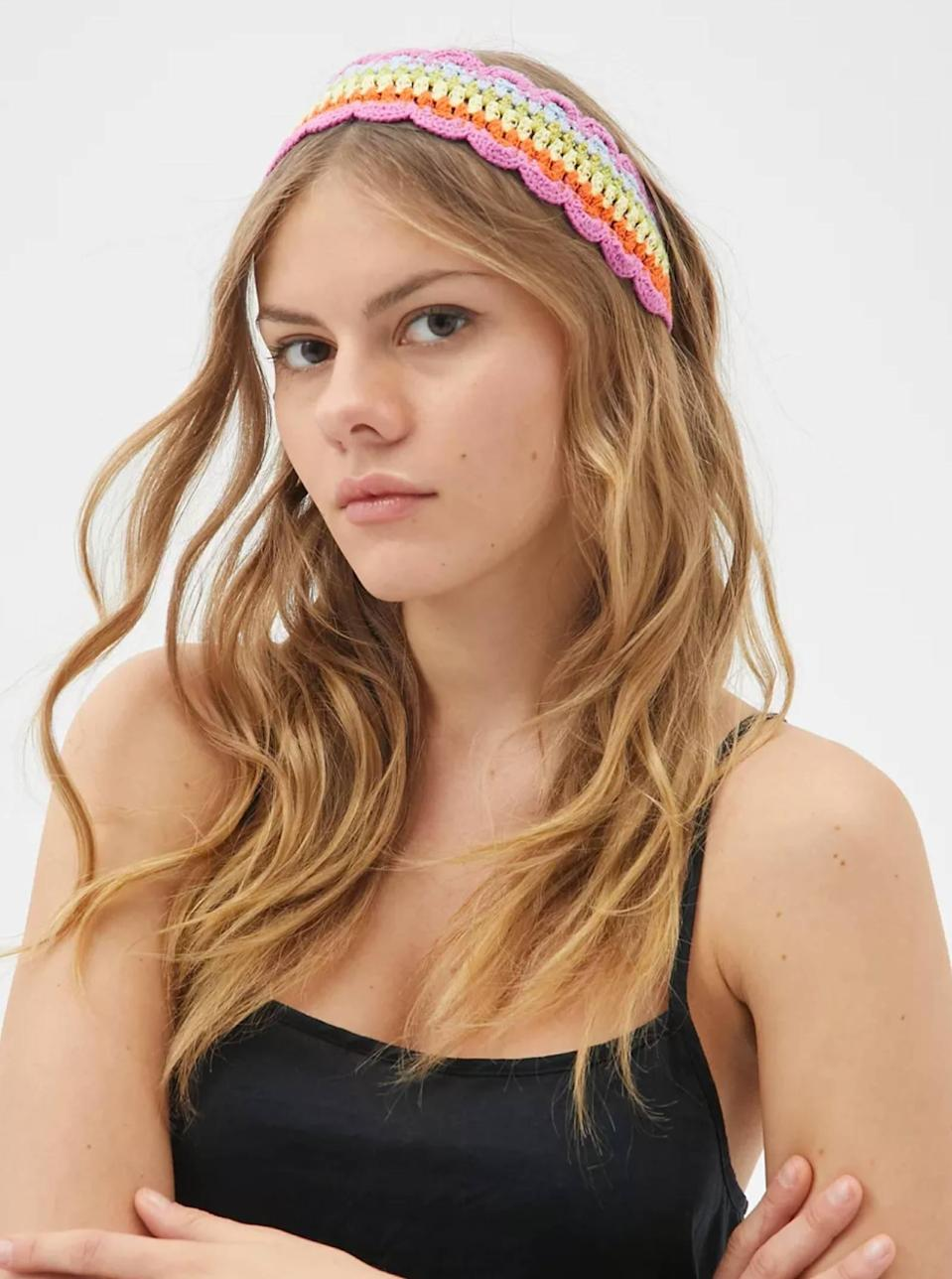 """Over your padded headband? Try this knit option as a fresh alternative, which will add instant flair to a messy updo or long, flowing <a href=""""https://www.glamour.com/story/how-to-grow-hair-faster?mbid=synd_yahoo_rss"""" rel=""""nofollow noopener"""" target=""""_blank"""" data-ylk=""""slk:quarantine hair"""" class=""""link rapid-noclick-resp"""">quarantine hair</a>. $12, Urban Outfitters. <a href=""""https://www.urbanoutfitters.com/shop/shatzi-crochet-headband?"""" rel=""""nofollow noopener"""" target=""""_blank"""" data-ylk=""""slk:Get it now!"""" class=""""link rapid-noclick-resp"""">Get it now!</a>"""