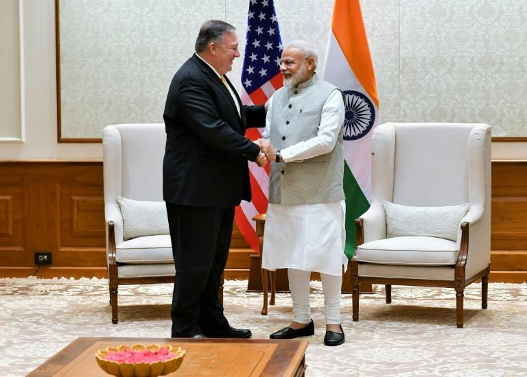US Secretary of State Mike Pompeo shakes hands with Indian Prime Minister Narendra Modi during their meeting (AFP Photo/Handout)