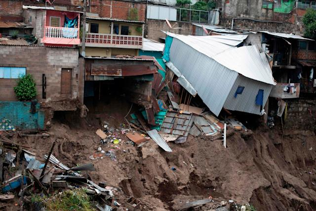 A view of houses devastated by the overflowing of a creek due to the torrential rains caused by the tropical storm Amanda in San Salvador: AFP via Getty Images