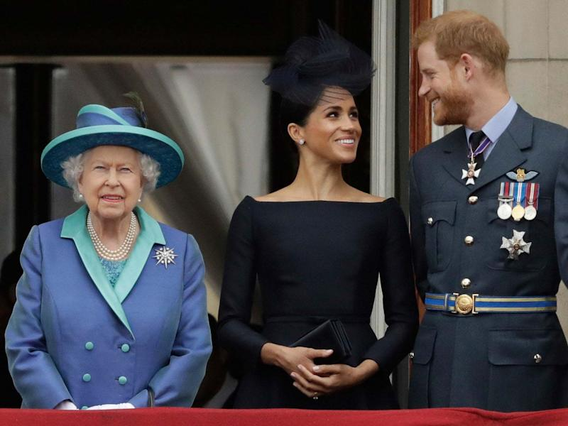 File photo of Queen Elizabeth II, Meghan Markle and Prince Harry: AP