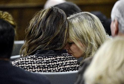 Taya Kyle, left, widow of sniper Chris Kyle, listens to her friend, Amy Novacek, during the trial on Tuesday. (AP Photo/The Dallas Morning News, Michael Ainsworth, Pool)