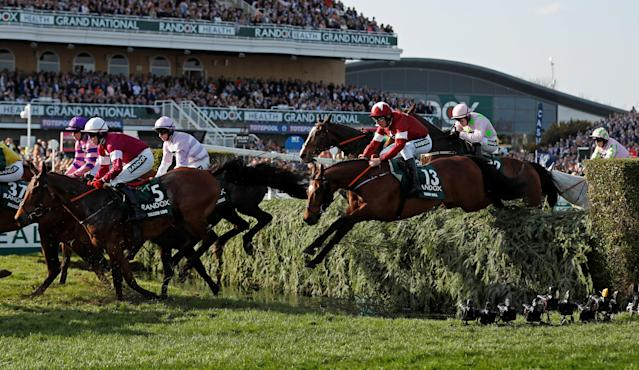 Horse Racing - Grand National Festival - Aintree Racecourse, Liverpool, Britain - April 14, 2018 Tiger Roll ridden by Davy Russell (R) in action before winning the 17:15 Randox Health Grand National Handicap Chase Action Images via Reuters/Matthew Childs