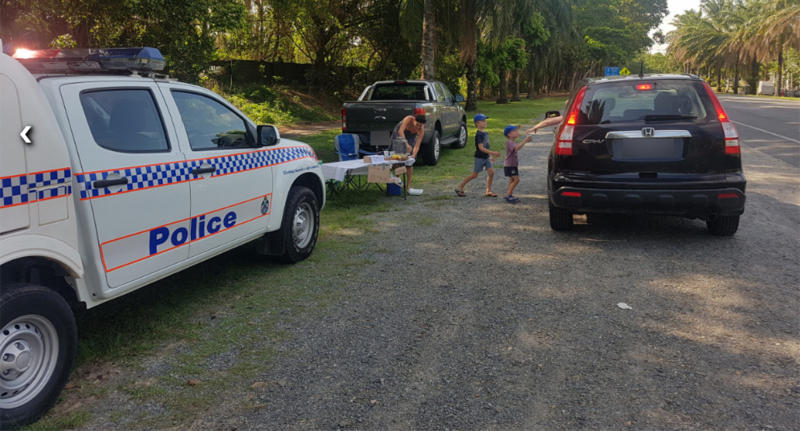Jack and Will Reilly serve up lemonade to drivers who were breath tested in Port Douglas.
