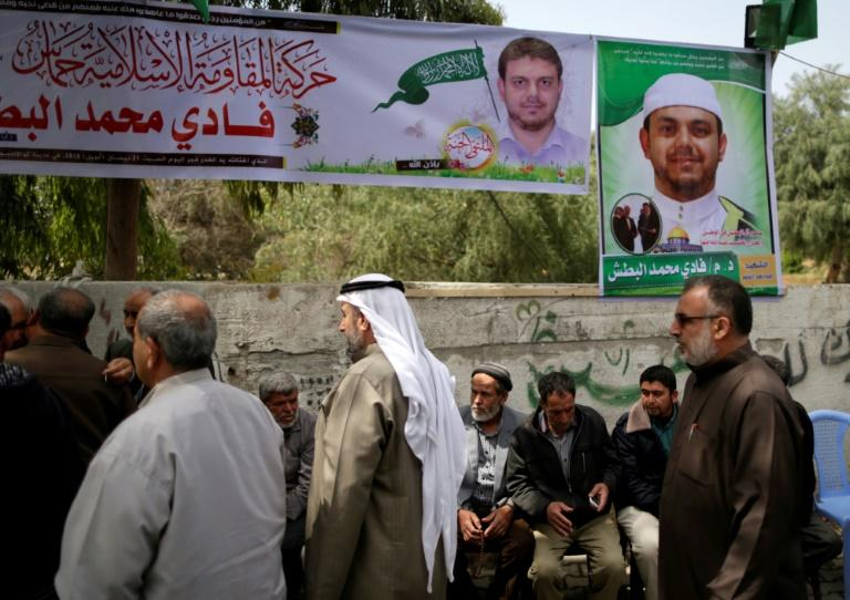 Palestinians gather in mourning outside the family home of 35-year-old professor and Hamas member Fadi Mohammad al-Batsh, who was killed early in the day in Malaysia, in Jabalia in the northern Gaza strip on April 21, 2018