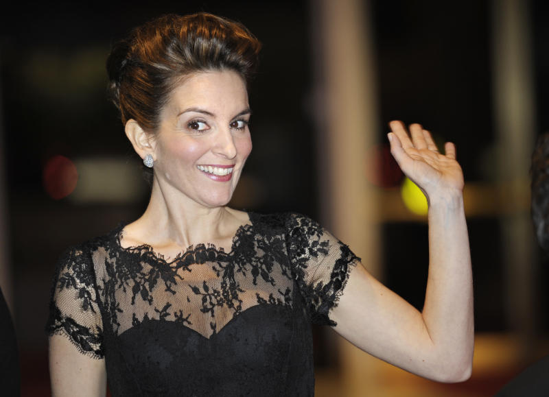 Tina Fey waves to fans as she arrives at the Kennedy Center where she was awarded the Mark Twain Prize for humor in Washington, Tuesday, Nov. 9, 2010. (AP Photo/Cliff Owen)