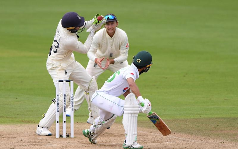 Jos Buttler took a quality catch off the bowling of Dom Bess to give England their fifth wicket - Getty