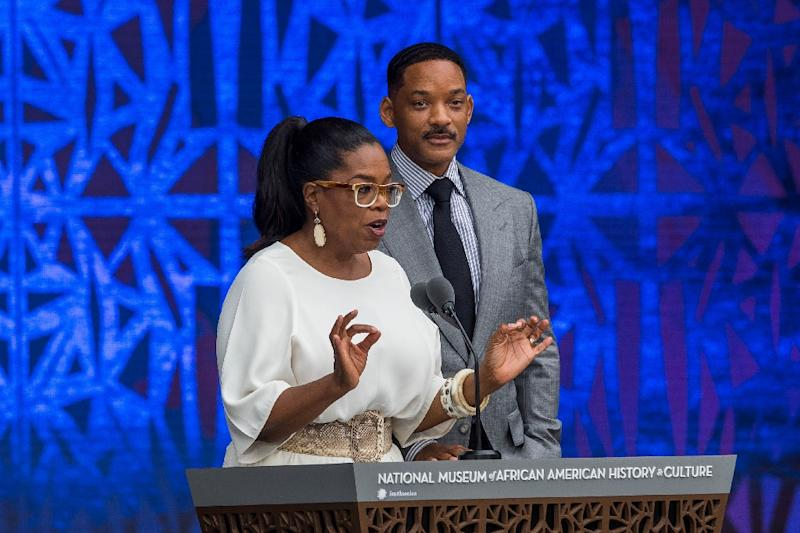 Oprah Winfrey and Will Smith attend the opening ceremony for the Smithsonian National Museum of African American History and Culture in Washington on September 24, 2016 (AFP Photo/Zach Gibson)