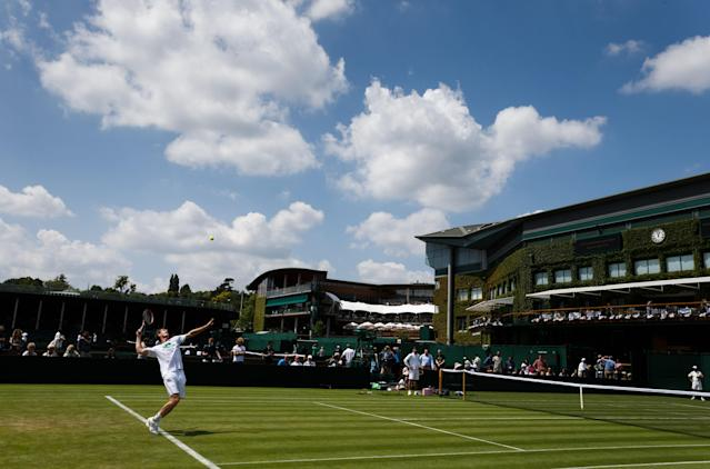 Britain's Andy Murray practices on court 7 at the All England Lawn Tennis and Croquet Club, Wimbledon, England, Saturday, June 21, 2014. The 2014 Wimbledon Championships will start on Monday. (AP Photo/John Walton, PA Wire)