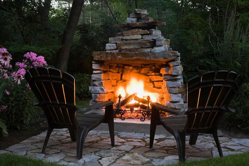 """<p>There's just something so cozy about a fire this time of year—the crackle, the smell, roasting hot dogs, and toasting marshmallows for the <a href=""""https://www.countryliving.com/food-drinks/a28189946/smores-recipe/"""" rel=""""nofollow noopener"""" target=""""_blank"""" data-ylk=""""slk:best s'mores recipes"""" class=""""link rapid-noclick-resp"""">best s'mores recipes</a>. Even though campfires get most of the glory, homeowners are embracing the romantic appeal of enjoying a fire in their very own backyards. More and more, when deciding on the <a href=""""https://www.countryliving.com/gardening/garden-ideas/g2314/backyard-ideas/"""" rel=""""nofollow noopener"""" target=""""_blank"""" data-ylk=""""slk:best ideas for backyards"""" class=""""link rapid-noclick-resp"""">best ideas for backyards</a>, an outdoor fireplace or a fire pit is becoming a focal point in the design. And it's no wonder—remember that part about s'mores?</p><p>Whether you have a large, sprawling back lawn space or are looking for <a href=""""https://www.countryliving.com/gardening/news/g4183/small-backyard-ideas/"""" rel=""""nofollow noopener"""" target=""""_blank"""" data-ylk=""""slk:best ideas for small backyards"""" class=""""link rapid-noclick-resp"""">best ideas for small backyards</a>, an outdoor fireplace or fire pit is something to consider. Custom built-in designs can be on the pricier side, but for smaller budgets, there are plenty of super affordable options for fire pits and chimineas (a great pick for small spaces!) that are just a click away on Amazon. If you're in the mood for a project, try your hand at one of these DIY outdoor fireplace tutorials.</p><p>Either way, you can be relaxing by the glow of an outdoor fire in no time, whether you buy a fire pit for your patio or build an outdoor fireplace from scratch. Now, who's bringing the hot dogs and marshmallows?</p>"""
