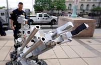 Cleveland police bomb squad technician Sgt. Tim Maffo-Judd demonstrates a Remotec F5A explosive ordnance device robot during a demonstration of police capabilities across the street from city hall near the site of the Republican National Convention in Cleveland, Ohio July 14, 2016. REUTERS/Rick Wilking