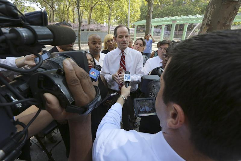 New York City comptroller candidate Eliot Spitzer speaks to reporters after touring the Frederick Douglass Houses, Wednesday, Aug. 21, 2013 in New York. Spitzer called for sweeping reforms to the public housing system and delivers a sharp rebuke of Mayor Michael Bloomberg's suggestion of fingerprinting tenants. (AP Photo/Mary Altaffer)